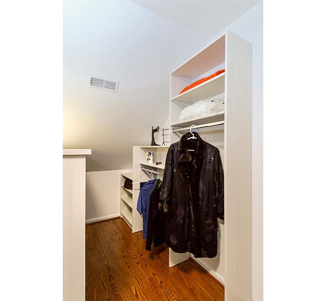 Closet shelves that fit and step down to the size of an angled ceiling