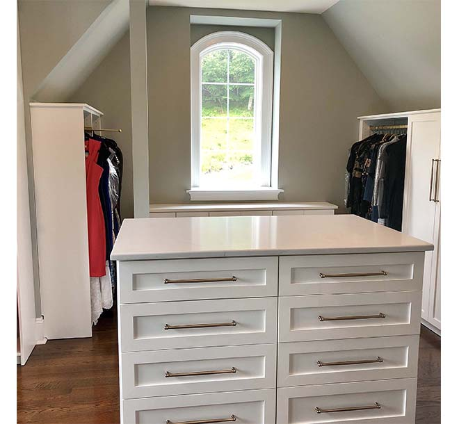 Custom walk in closet fit around slanted and sloped ceilings