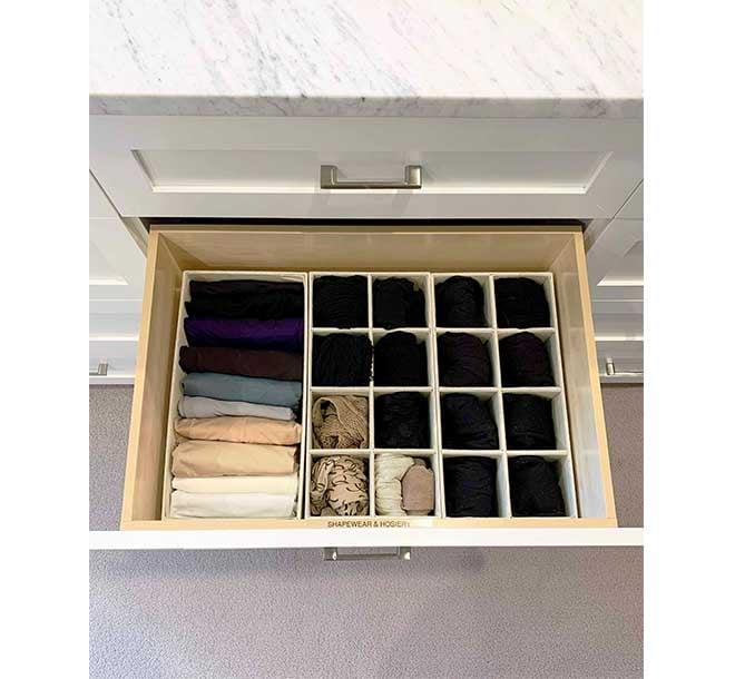 Walk-in closet drawer inserts keeping hosiery organized
