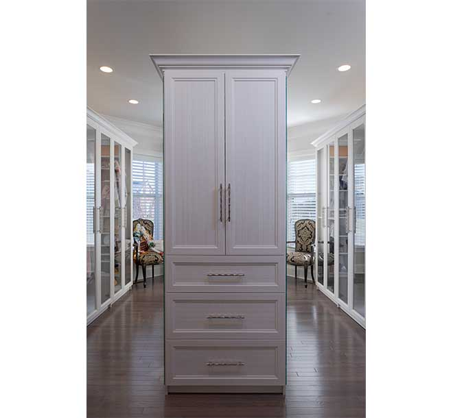 Traditional walk-in closet space with center island