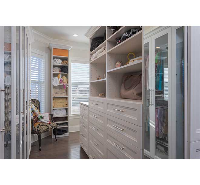 walk-in closet with large standing cabinet