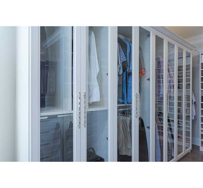 Clothing organized in cabinet with glass doors
