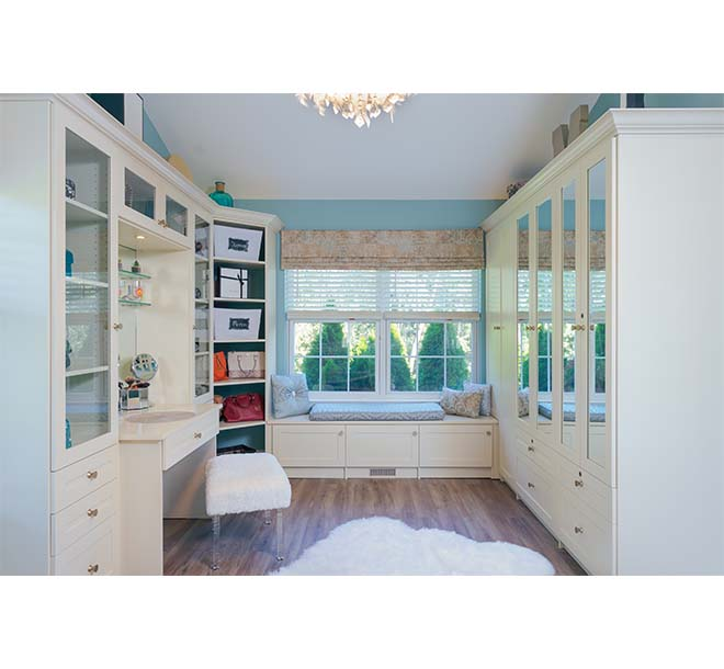 Chic style largenwalk-in closet with beautiful cabinets finished in an almondine color
