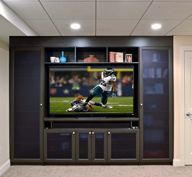 Media center design with custom shelves and glass door inserts