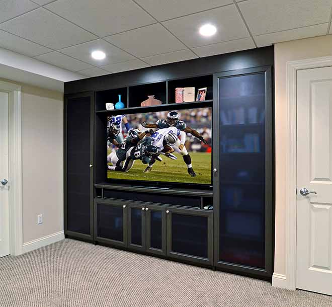 Entertainment center with custom built in wall unit cabinet