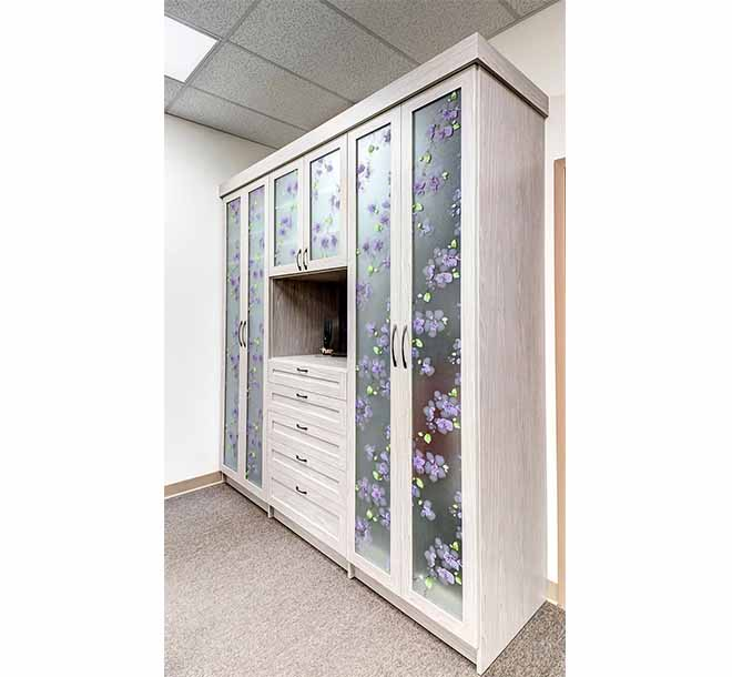 Wardrobe closet with glass door inserts and unique floral design