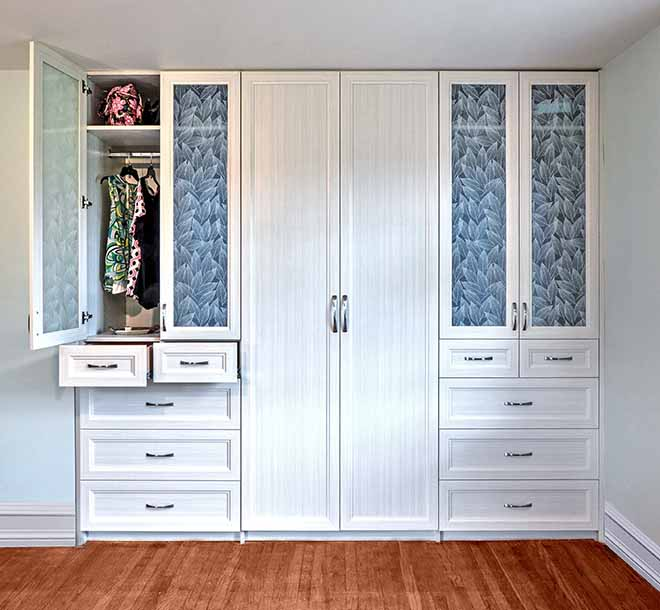 Beautiful built-in custom wardrobe with cabinet doors and glass inserts