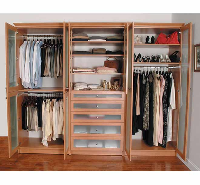 Classic wardrobe with his and her clothing items organized