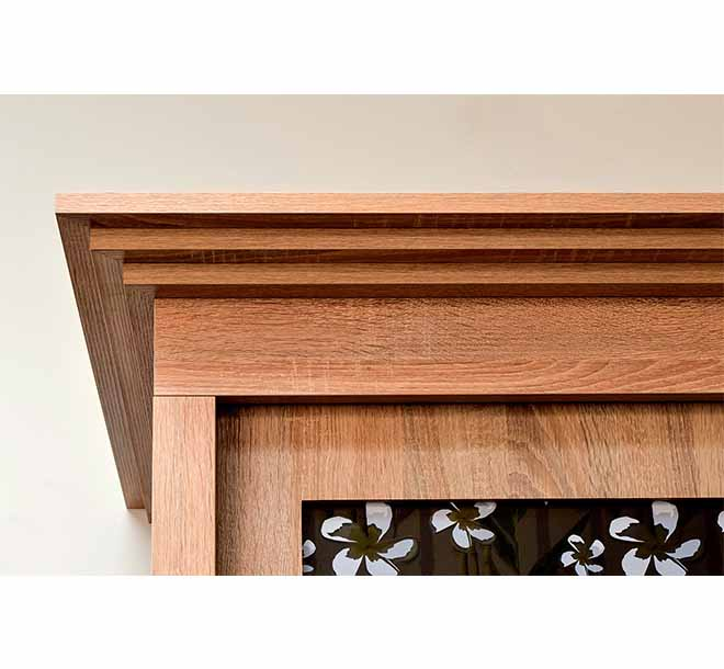 Crown molding built-in to the top of a wardrobe furniture piece