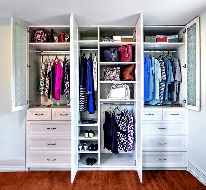 Custom wardrobe closet with clothing and wardrobe items neatly orgaznied
