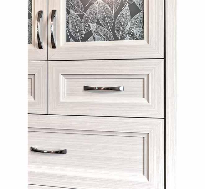 Custom wardrobe drawers finished with decorative hardware