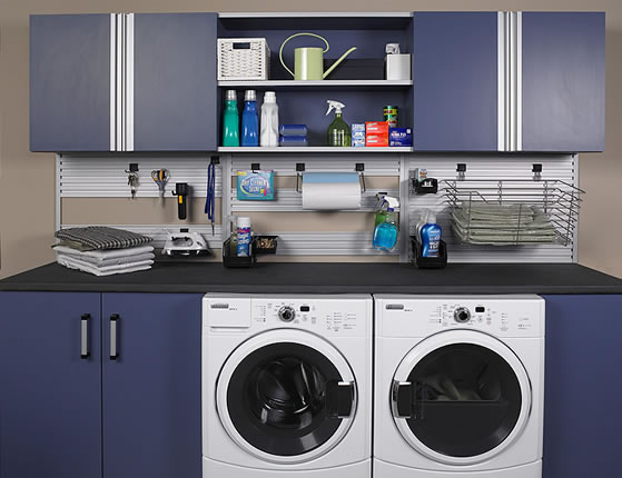 Laundry room with washer and dryer neatly organized