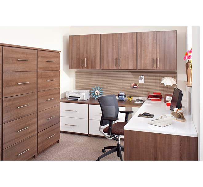 Commercial office with large filing cabinet behind and desk