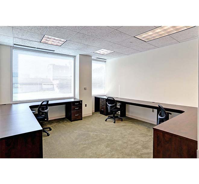 Commerical office with large open area and custom built desks for mutliple workspaces