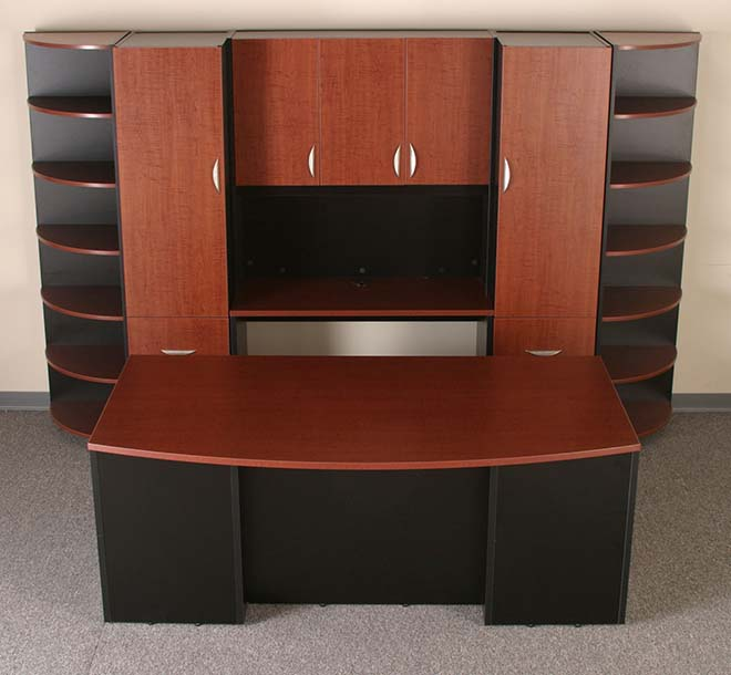 Custom built desk and cabinet with rounded shleving