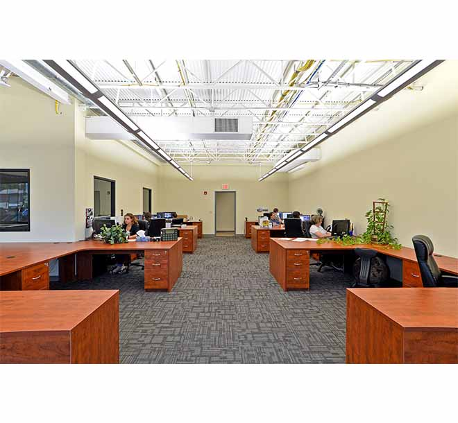 Commercial office space with custom built desks and open design