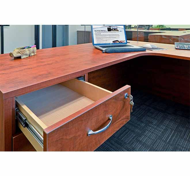 Custom built doverail plywood drawer open below desk space