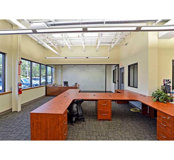 Custom commercial office design with wraparound desks