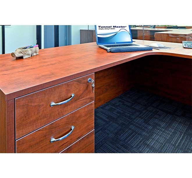 Wraparound desk space with locked bottom cabinets