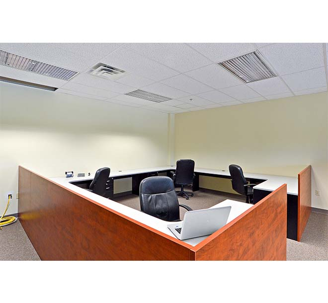 Two toned custom commercial office design with wrapround workspace