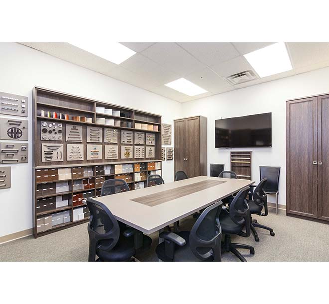 Conference room with large center table in commercial office