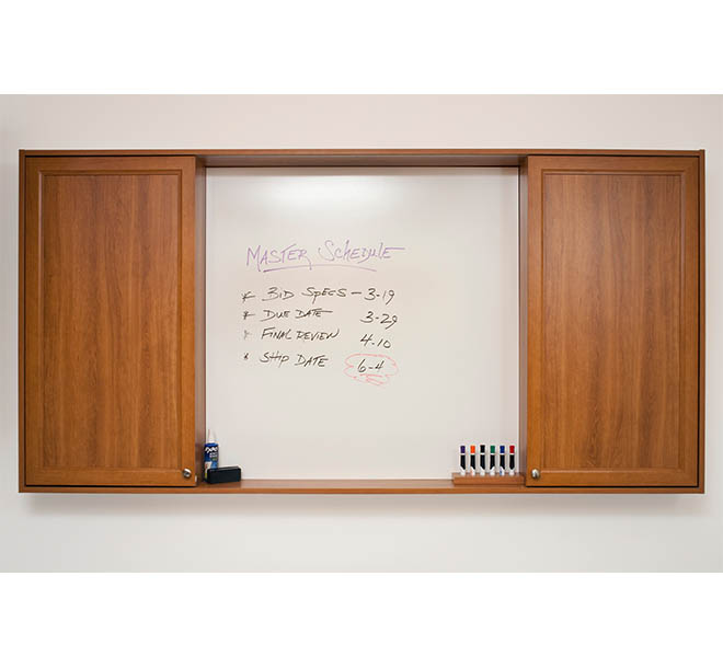 Custom center cabinet doors slid open with whiteboard