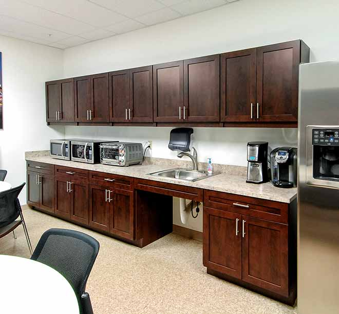 Commercial office kitchen with custom built cabinets