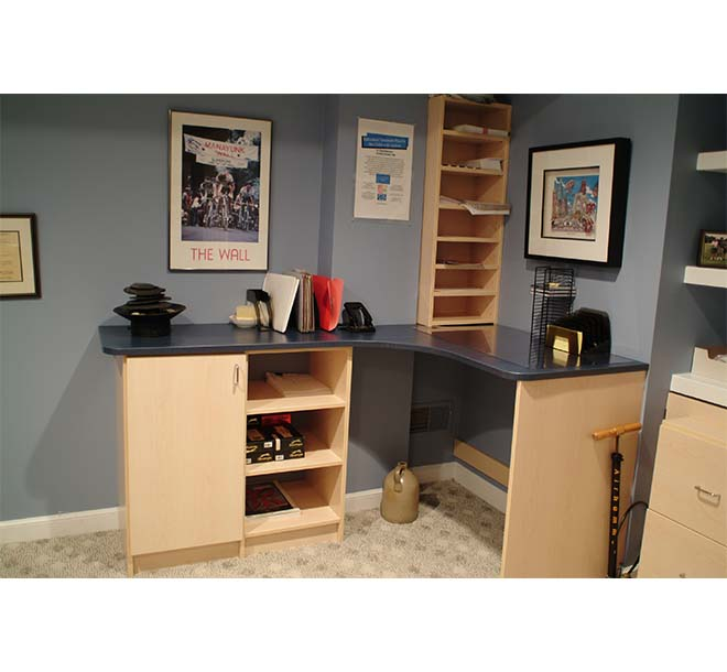 Office with custom corner workstation and additional storage cabinets