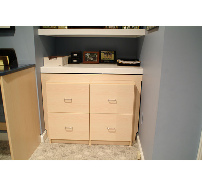 Work surface with custom built filing drawers in small agled space