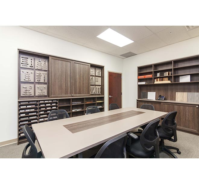 Display board with sliding doors behind conference room table