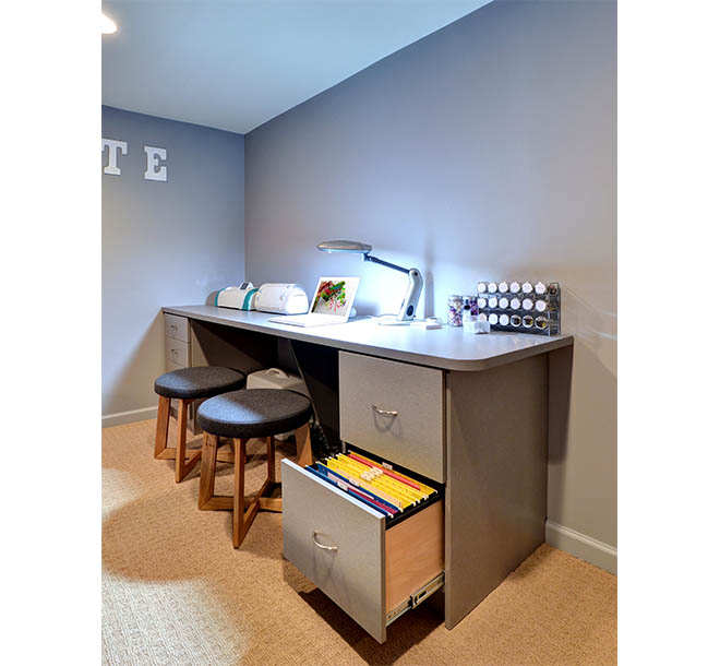 Craft room with additional desk work area and drawer storage