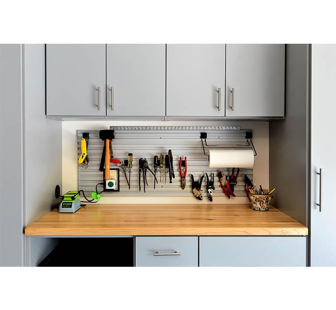 Garage hand tools organized on magnetic bar