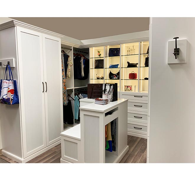 Closet system with Ceasarstone Pure White top center island
