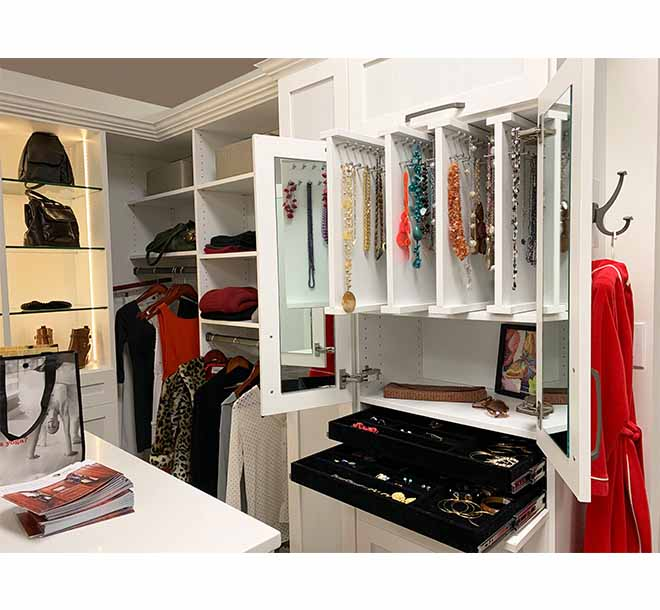 Jewelry storage with sliding vertical shelves and drawer inserts