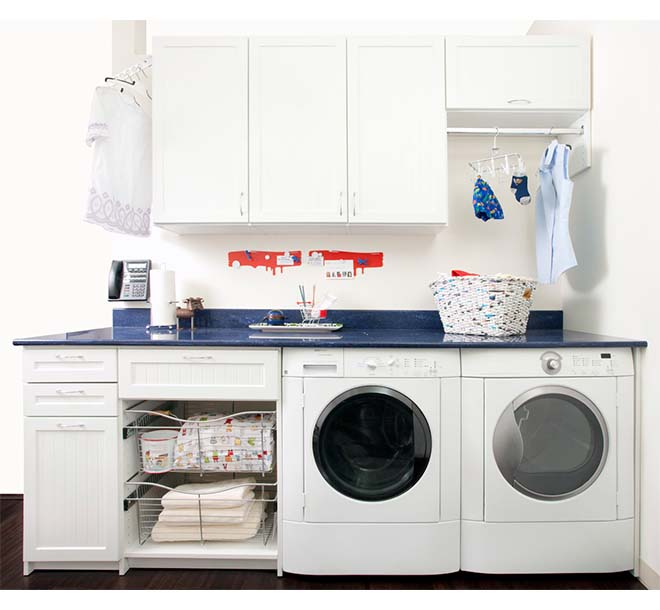 Organized laundry area with clothing hung and towels in baskets