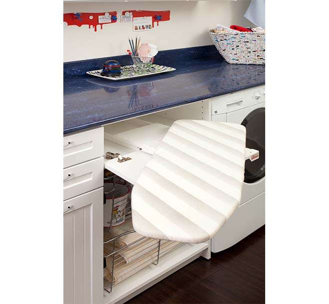 Space saving swivel out ironing board