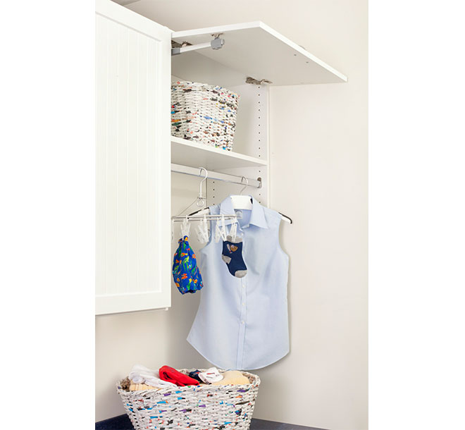 Clothing hung and folded in baskets neatly organized