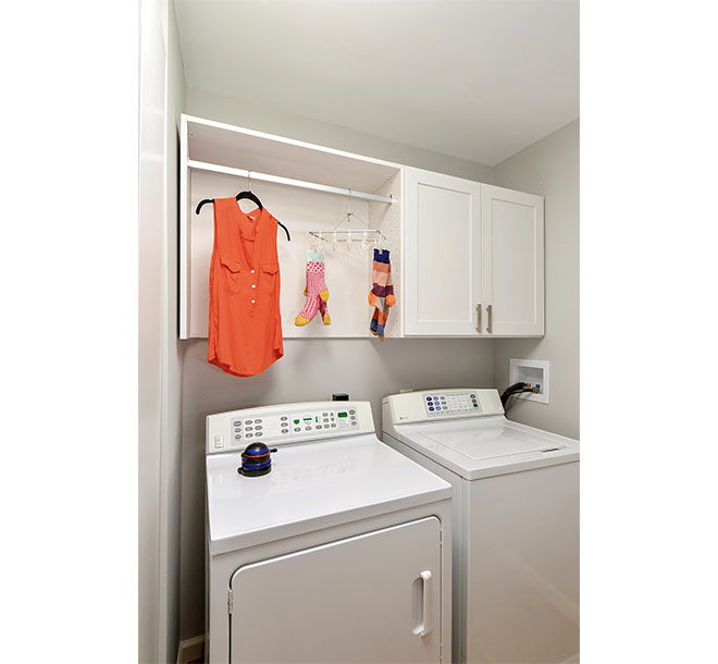 Clothes drying and hung above washer and dryer