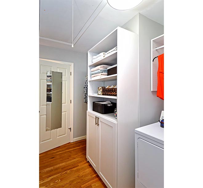 Custom laundry room shelves filled with household items
