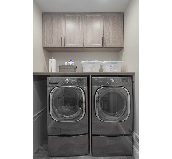 Laundry room with counter space above washer and dryer