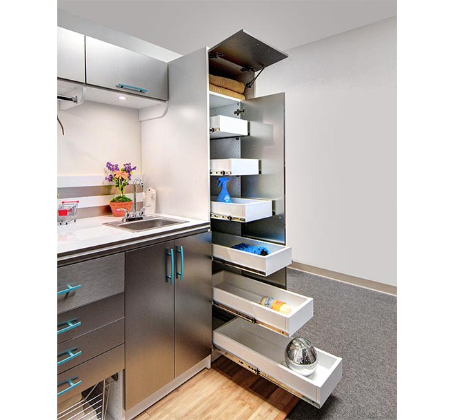 Laundry room items organized on pull out shelves