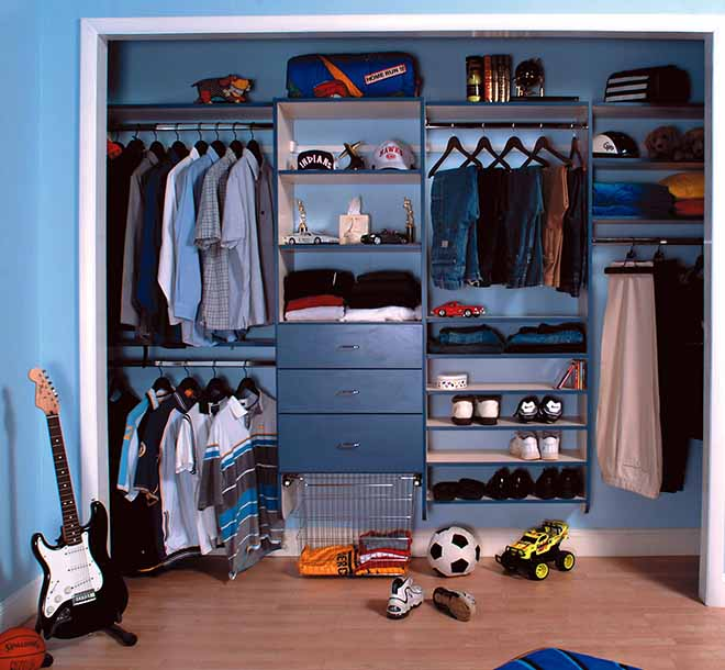 Boys Reach-In Closet with toys and clothing organized and tidy