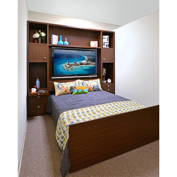 Zoom room bed open and neatly made below media center