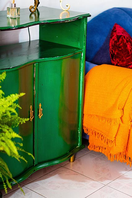 Vibrant green cabinet near couch