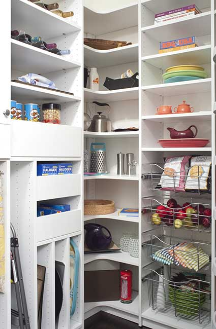 Kitchen pantry with L-shaped corner shelving