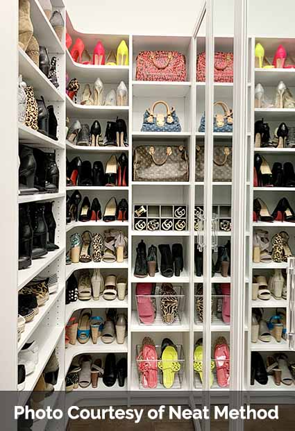 Walk in closet with shoe storage neatly displayed