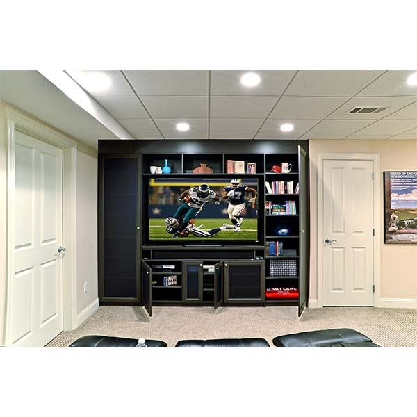 Custom built media center with cabinets and shelves