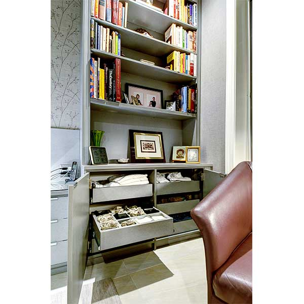 Custom built bedside storage furniture piece with roll-outs