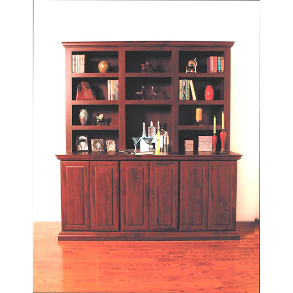 Collectibles and spirits displayed on a custom furniture piece
