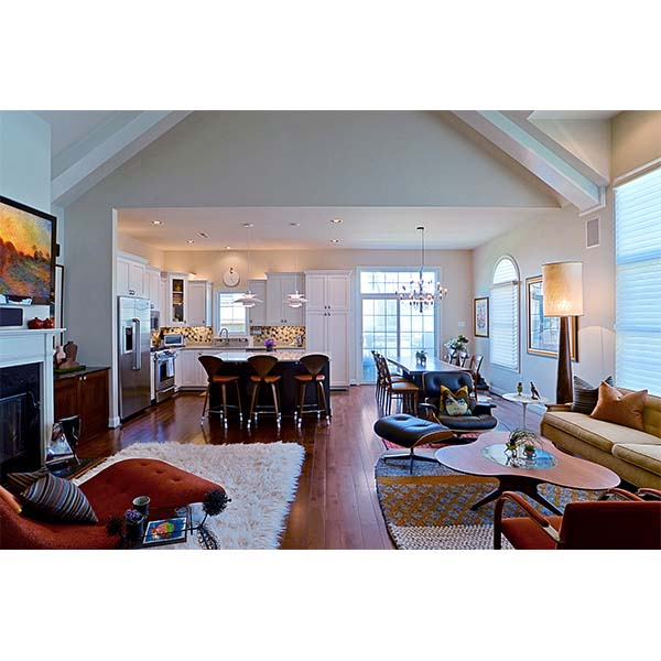 Open livingroom and kitchen space with hardwood floors and custom built furniture